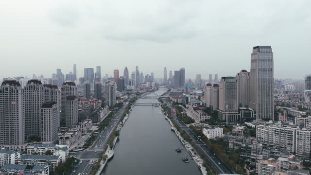 aerial view of river and skyline - liyao xie stock videos & royalty-free footage