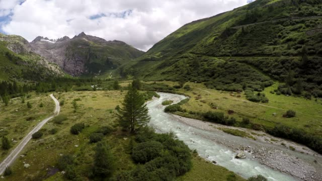 Aerial view of river flowing through scenic alpine environment