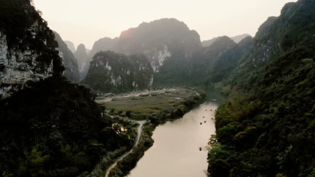 aerial view of river in the mountains in vietnam - mountain range stock videos & royalty-free footage