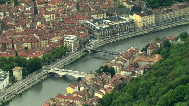 ws aerial view of river isere through grenoble, rhone-alpes, france - grenoble stock-videos und b-roll-filmmaterial