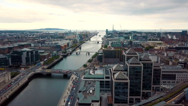 aerial view of river liffey and city of dublin towards dublin bay, with samuel beckett bridge/ ireland - dublin republic of ireland stock videos & royalty-free footage