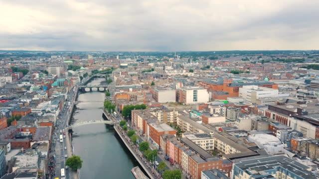 aerial view of river liffey and ha'penny bridge, dublin/ ireland - dublin republic of ireland stock videos & royalty-free footage