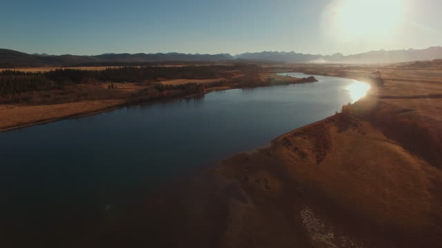 aerial view of river through dry fields - clear sky stock videos & royalty-free footage