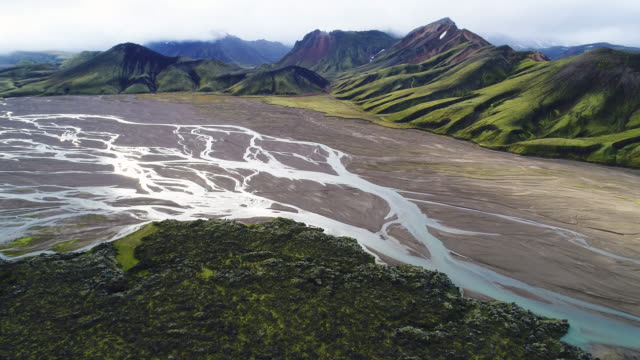 aerial view of rivers, valley and mountains in landmannalaugar, iceland - stream stock videos & royalty-free footage