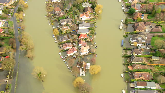 aerial view of riverside flooding surrey england uk - flood stock videos & royalty-free footage
