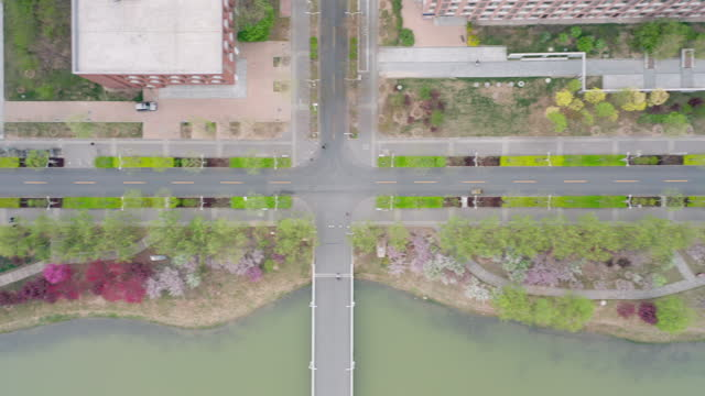 aerial view of road along the river - liyao xie stock videos & royalty-free footage