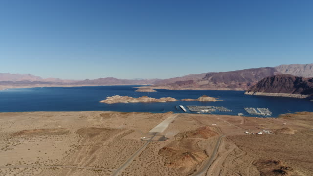 aerial view of road and lake mead - lake mead video stock e b–roll