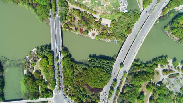 aerial view of road by lake taihu - motorway stock videos & royalty-free footage