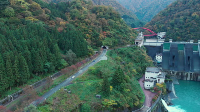 aerial view of road in autumn season, toyama, japan. - toyama prefecture stock videos and b-roll footage
