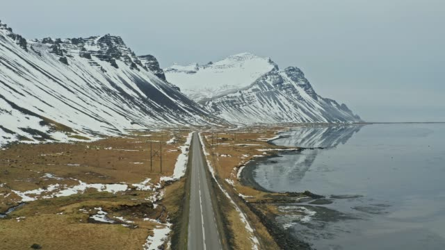 aerial view of road in iceland near the sea at winter - dramatic landscape stock videos & royalty-free footage