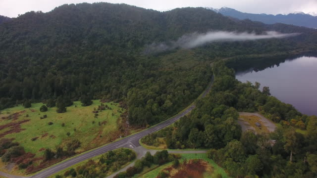 aerial view of road in south island. - fen stock videos and b-roll footage