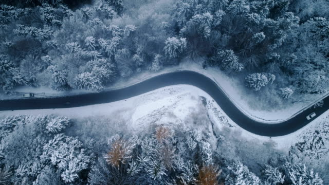aerial view of road in winter - drone point of view stock videos & royalty-free footage