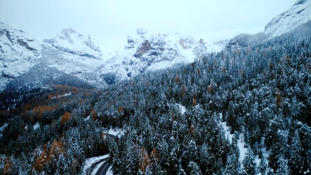 aerial view of road in winter - mountain range stock videos & royalty-free footage