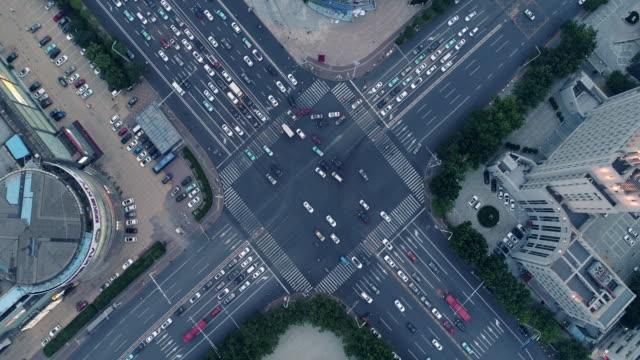 aerial view of road intersection - traffic stock videos & royalty-free footage