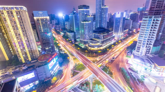 aerial view of road junction in midtown of modern city at night time lapse - hangzhou stock videos & royalty-free footage