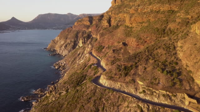 aerial view of road on a cliffside coastline - cape town stock videos & royalty-free footage