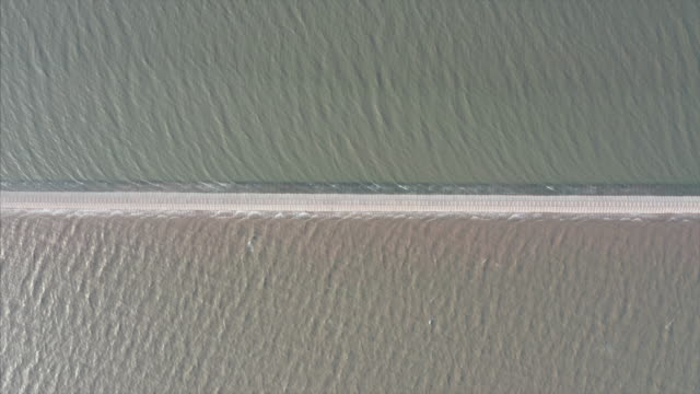 aerial view of road on the sea - separation stock videos & royalty-free footage