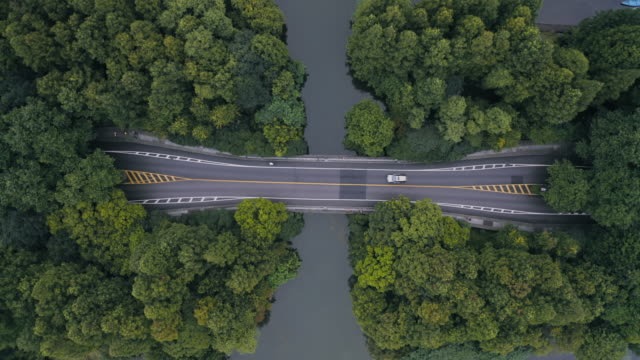 aerial view of road over west lake - liyao xie stock videos & royalty-free footage