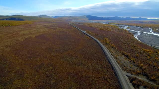 vidéos et rushes de aerial view of road through the far east wasteland,russia - étendue sauvage état sauvage