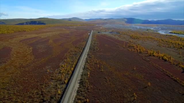vidéos et rushes de aerial view of road through the far east wasteland,russia - étendue sauvage scène non urbaine