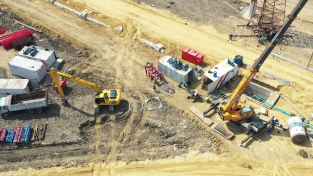 aerial view of road under construction site - roadworks stock videos & royalty-free footage