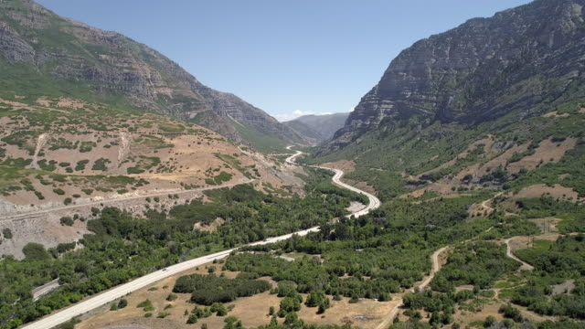 stockvideo's en b-roll-footage met aerial view of road winding through canyon - provo