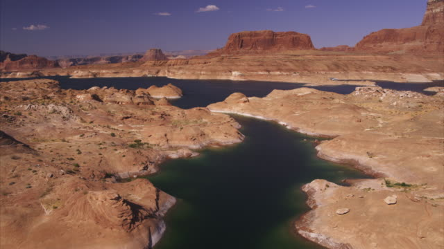 aerial view of rock formations and lake / lake powell, arizona, united states - lago powell video stock e b–roll