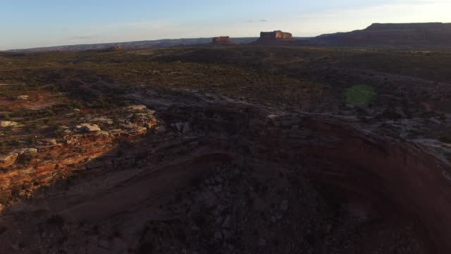 aerial view of rocky cliffs on barren landscape against sky, drone moving forward over desert - moab, utah - moab utah stock videos & royalty-free footage