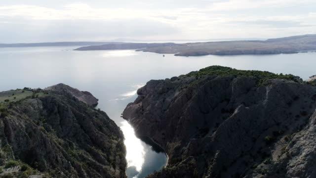 aerial view of rocky coast with estuary. zavratnica bay - ravine stock videos & royalty-free footage
