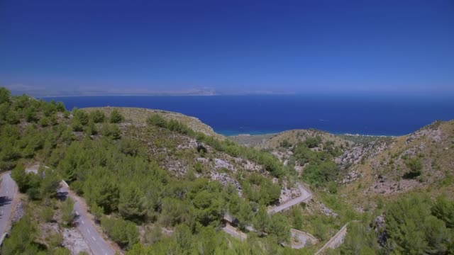 Aerial View of rocky coastline and coastal plain near by Ermita de Betlem in the mountains of Artà ( Serra Artana or Massís d'Artà ) of Balearic Islands Majorca / Spain