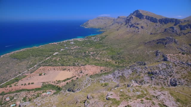 Aerial View of rocky coastline and coastal plain near by Ermita de Betlem in the mountains of Artà ( Serra Artana or Massís d'Artà ) of Balearic Islands Majorca / Spain