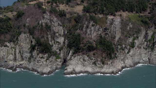 aerial view of rocky coastline and sea at keumodo island - rocky coastline stock videos & royalty-free footage