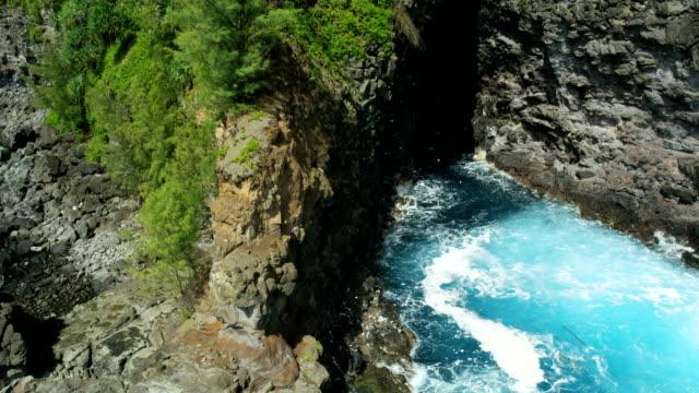 aerial view of rocky ocean coastline of maui - 谷点の映像素材/bロール