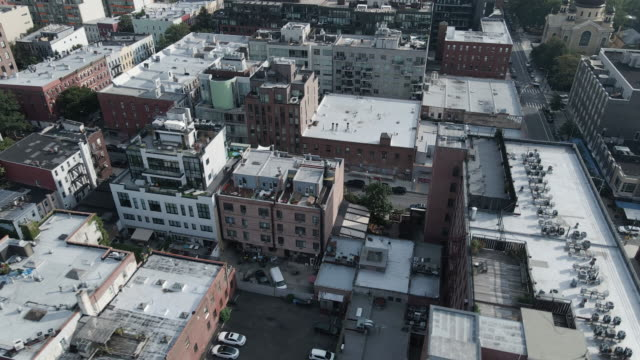 aerial view of rooftops in brooklyn, new york city - brooklyn new york stock videos & royalty-free footage