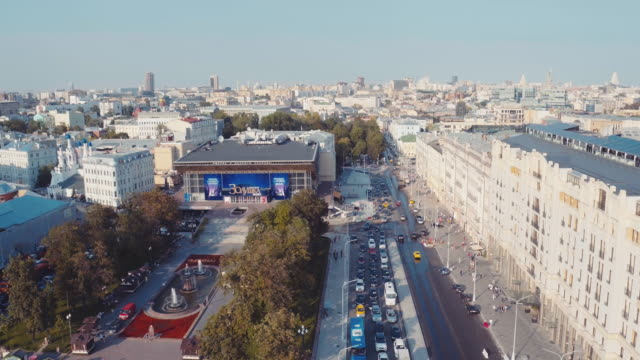 """aerial view of """"rossiya"""" theatre, izvestia building and strastnoy bulvar - russia stock videos & royalty-free footage"""