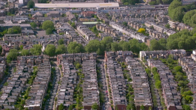 aerial view of rows of suburban victorian houses in london, uk. 4k - housing development stock videos & royalty-free footage