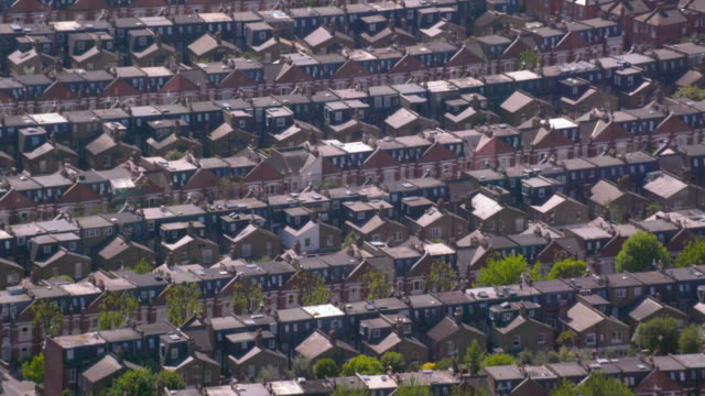 aerial view of rows of suburban victorian houses in london, uk. 4k - town stock videos & royalty-free footage