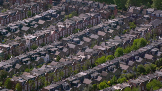 aerial view of rows of suburban victorian houses in london, uk. 4k - suburban stock videos & royalty-free footage