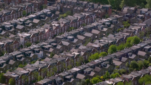 aerial view of rows of suburban victorian houses in london, uk. 4k - townhouse stock videos & royalty-free footage