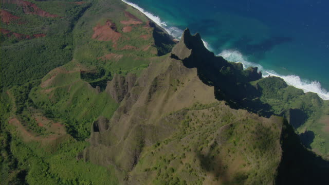 aerial view of rugged mountain ridge in na pali coast state park on the hawaiian island of kauai. - na pali coast state park stock videos & royalty-free footage