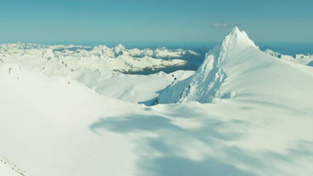 aerial view of rugged snow covered mountains alaska - mountain range点の映像素材/bロール