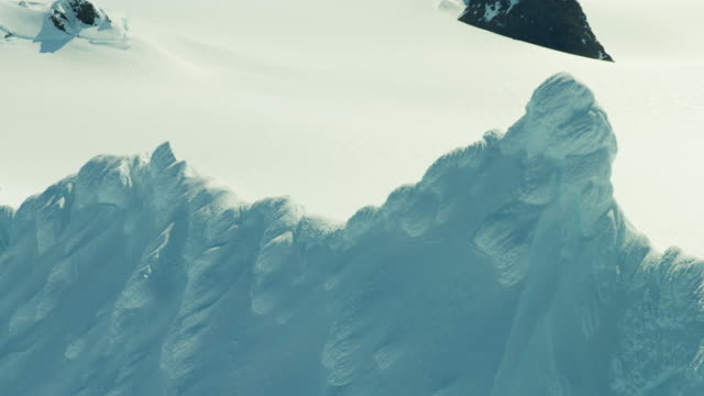 aerial view of rugged snow covered mountains alaska - eco tourism video stock e b–roll