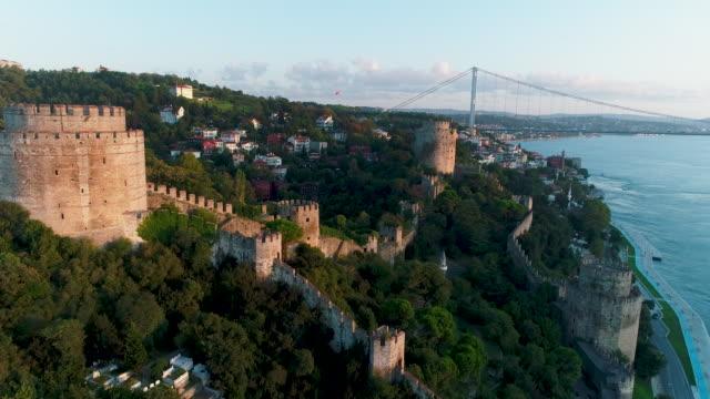 aerial view of rumeli fortress on istanbul bosphorus at sunrise (rumeli hisarı) - bosphorus stock videos & royalty-free footage