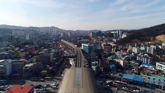 aerial view of running light-rail transit and cityscape in cheoingu, yongin city at daytime - komplexität stock-videos und b-roll-filmmaterial