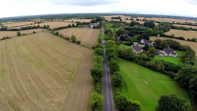 aerial view of rural houses and roads in ireland - housing development stock videos & royalty-free footage