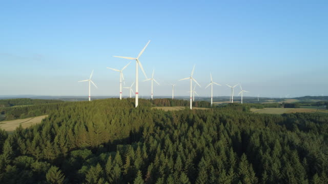 aerial view of rural landscape with wind turbines. hesse, germany, europe. - nachhaltige entwicklung stock-videos und b-roll-filmmaterial