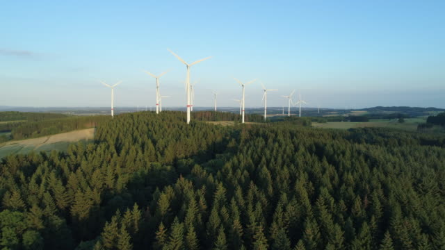 aerial view of rural landscape with wind turbines. hesse, germany, europe. - mill stock videos & royalty-free footage