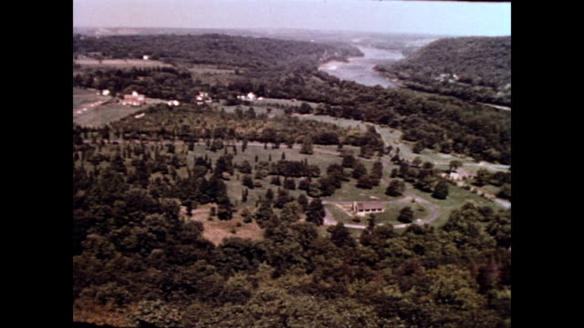 / aerial view of rural pennsylvania / ext bucks county playhouse / ext thomas neely house / horses in a field countryside around levittown pa on... - levittown pennsylvania stock videos and b-roll footage