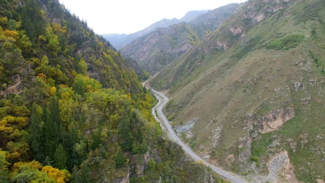 Aerial view of rural road between the autumn vegetation in mountains,Gansu,China.