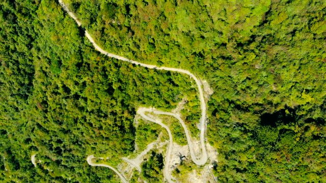 Aerial view of rural winding road in mountain